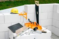 инструмент для возведения стен из блоков
